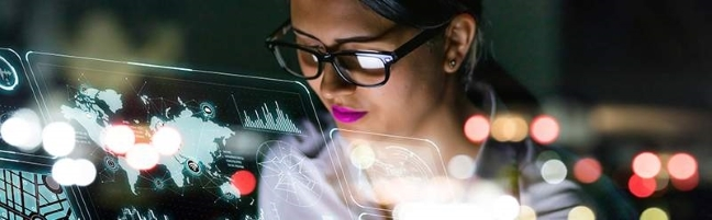 Woman looks through transparent screen with symbols