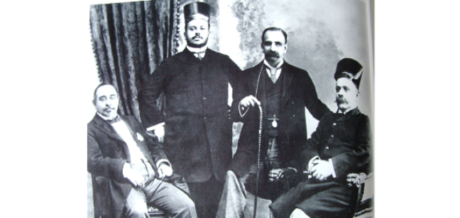 Black and white photograph of four smartly dressed Parsi industrialists