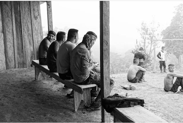 Members of FARC watch a game of football