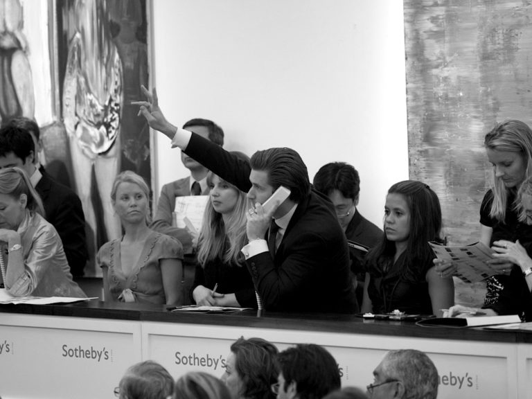 Photograph of telephone bidding in an auction house