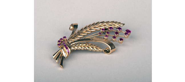 Small golden brooch in the shape of a grass bouquet, set with purple rubies