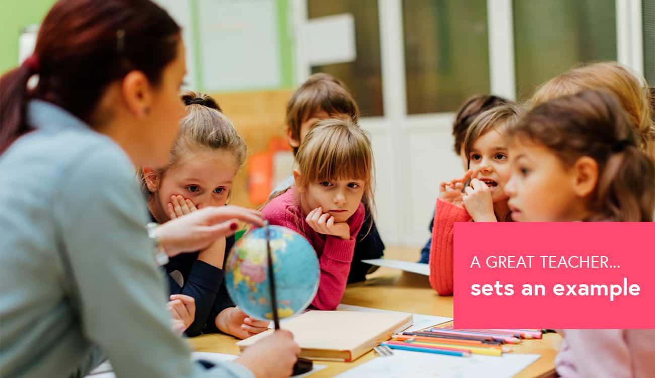 photo of a teacher with a globe