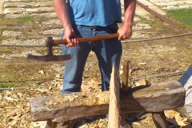 A person holding a broad axe