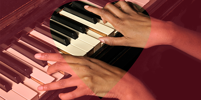 Photo of someone playing the piano