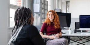 Two women communicating