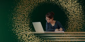 student with laptop studying with gold and green background