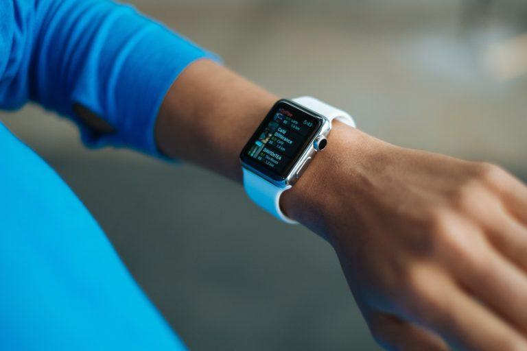 A mans wrist, showing a smartwatch running a calendar app