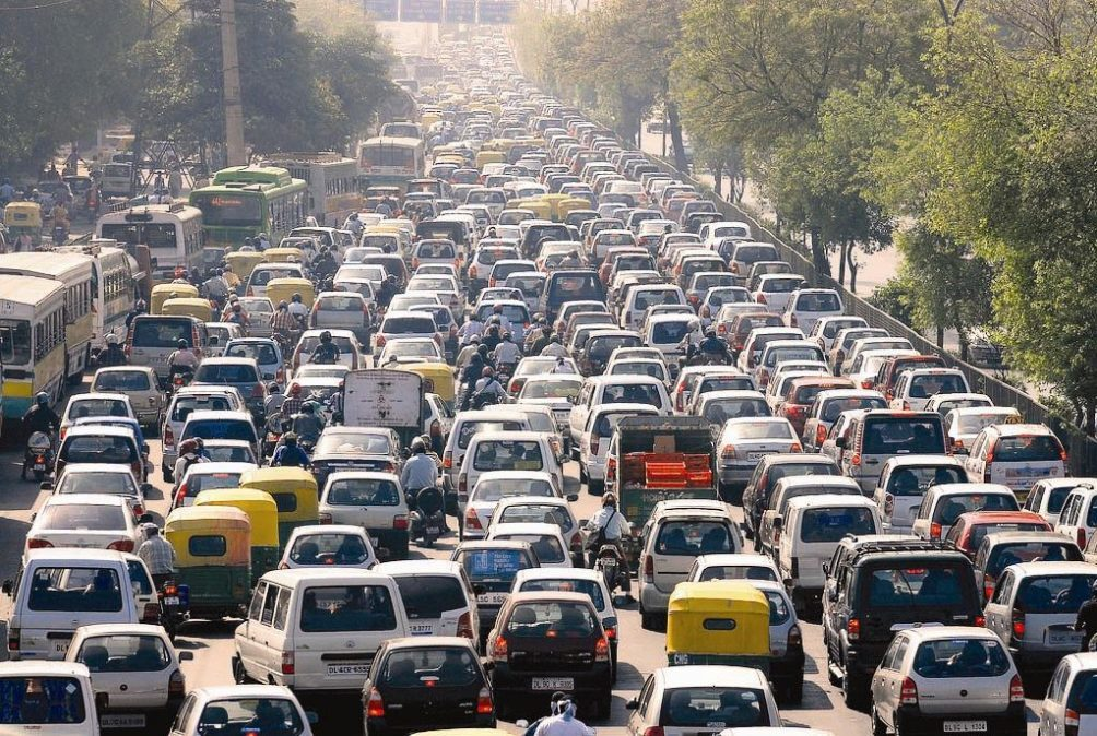 many cars and motorcycles in a traffic jam