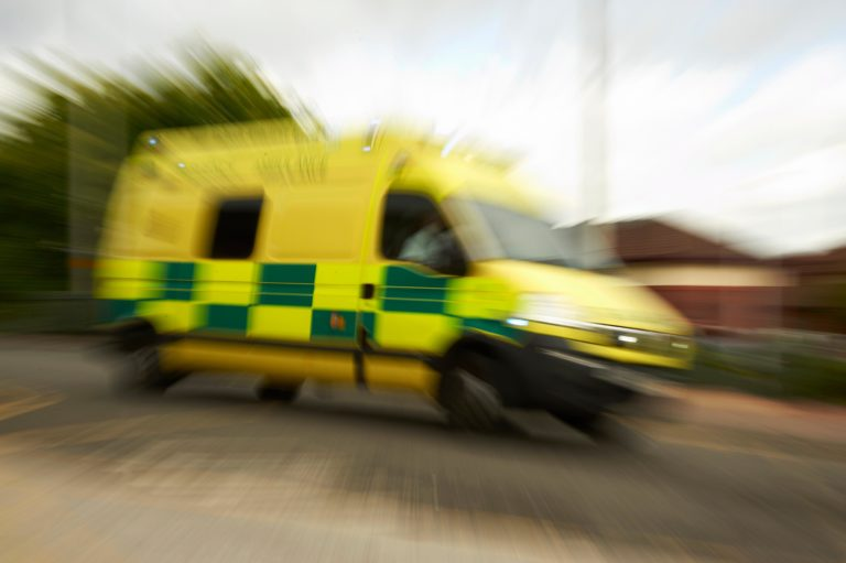 Photograph of an ambulance on route to an emergency call out