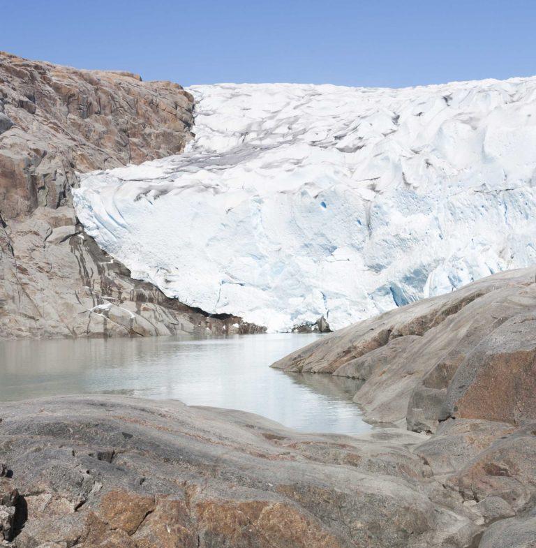 Wall of ice and rocky coast