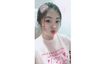 A selfie of a Chinese student edited by touch-up applications