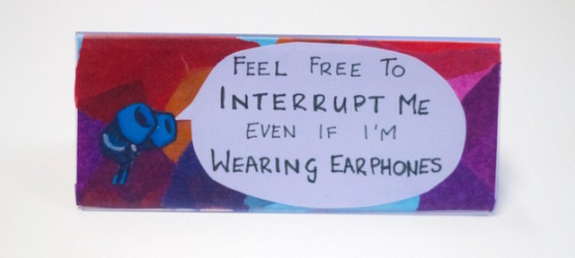 A desk sign at FutureLearn welcoming interruptions