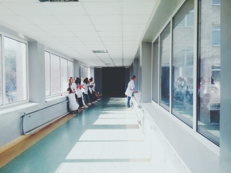 Photograph of people waiting in a hospital