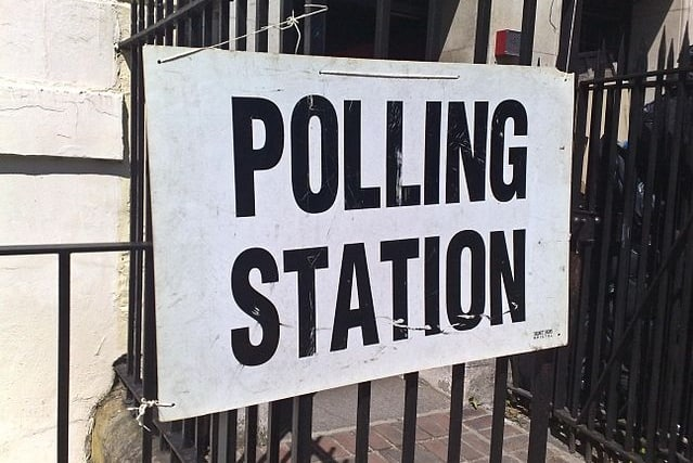 A polling station sign, indicating where people can vote in the UK General Election. Photo by secretlondon123 on Flickr.